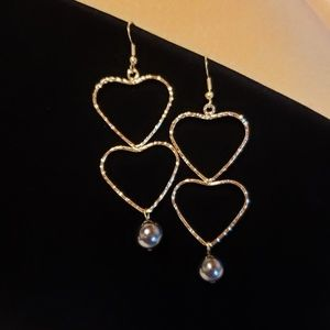 Double heart pearl earrings